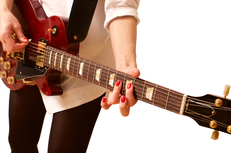 Young woman playing the guitar on white Reklamní fotografie