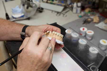 male dental technician working in dental laboratory Reklamní fotografie