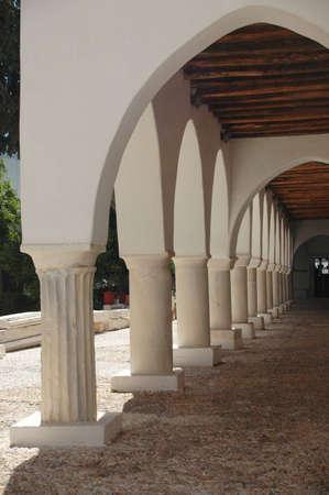 Columns line an overhang in a Greek monastery