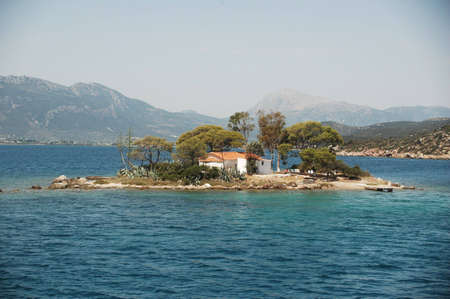 A tiny island sits alone in the mediterranean.