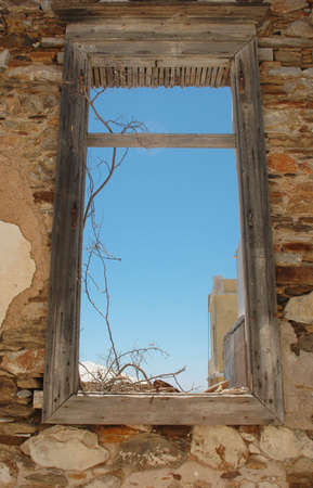 run down: A window in an old destroyed building Stock Photo