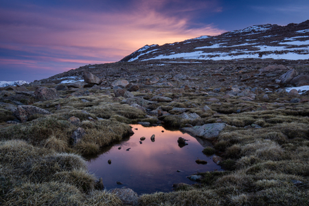 mount evans: Sunrise on Mount Evans Stock Photo
