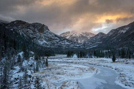 denver at sunrise: Early winter snow in Rocky Mountain National Park.  Taken on the East Inlet Trail, on the west side of the park. Stock Photo
