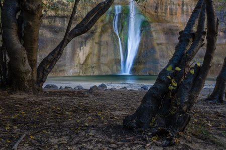 A short hike near Boulder, Utah leads to this gorgeous waterfall. Stock Photo