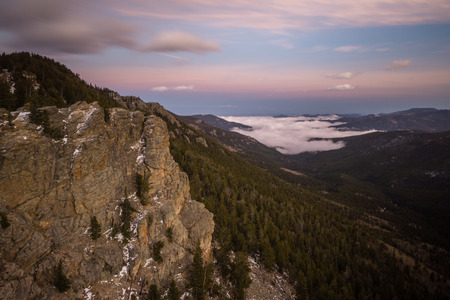 Fog fills a valley near Evergreen, Colorado.