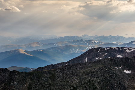 A hazy view after recent wildfires, light shines through late in the day.  From Mount Evans, Colorado Stock Photo
