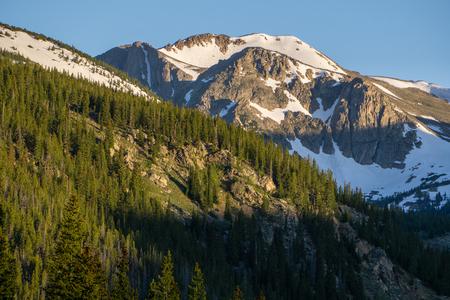 Shadows come across the valley near Lost Lake.  Nederland, Colorado. Stock Photo