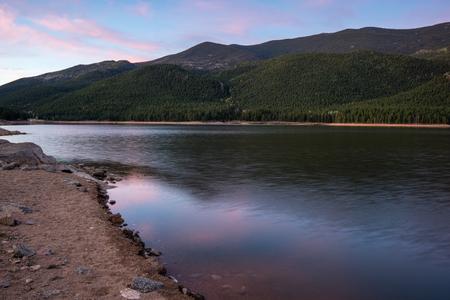 Sunrise at Wellington Lake, near Bailey, Colorado.