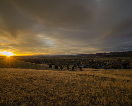 Cloudy sunrise in Lakewood, Colorado. Stock Photo