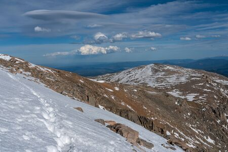 A snowy hike towards Mt Bierstadt, from the summit of Mount Evans.