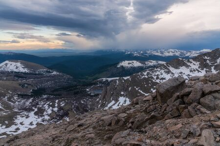 Rain clouds moving into South Park, from high above on Mount Evans.
