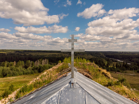 The silver cross on the roof of the church Stock Photo