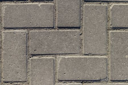 Grey paving stones as background. Grey granite cobblestone. Close-up. Top view. Imagens