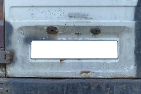 Close-up Of A Empty White Number Plate On dirty Car, copy space