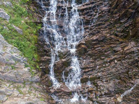 Mountain Waterfall with Drone Banco de Imagens - 128595487