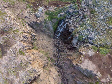 Mountain Waterfall with Drone Banco de Imagens - 128595414
