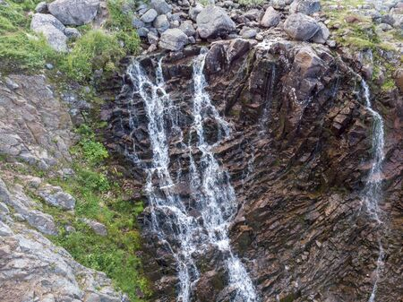 Mountain Waterfall with Drone Banco de Imagens - 128595416