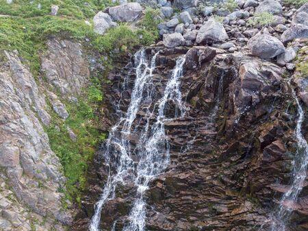 Mountain Waterfall with Drone Banco de Imagens - 128595430