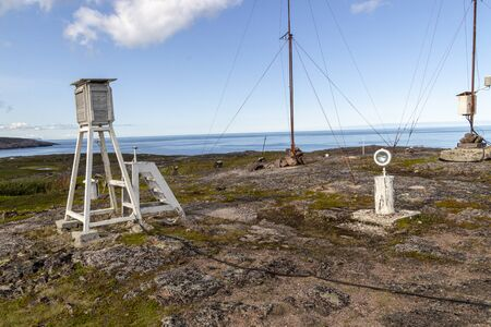 Weather station over the dam with mountain background Foto de archivo