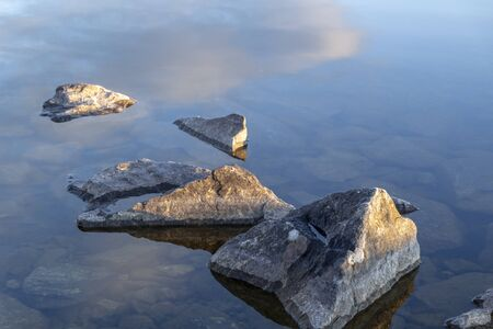 Reflection for natural grey stones for a corner Stock Photo