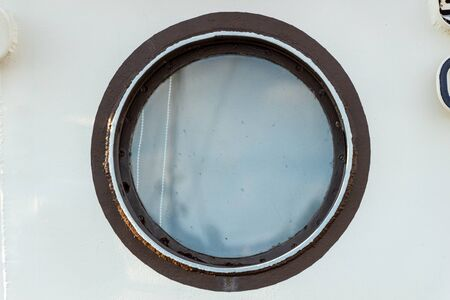 The porthole in the ships cabin is outside
