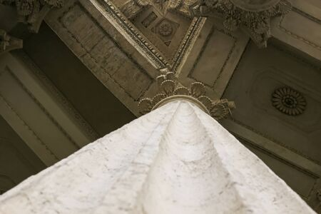 classic antique architecture marble columns enter to palace symmetry foreshortening from below.