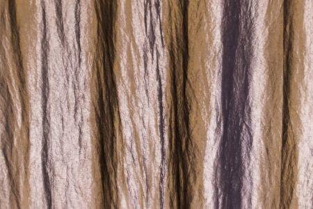 Crumpled beige fabric. Background, texture Stock fotó