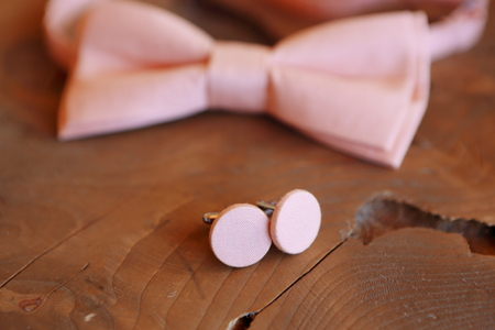 Close-up of a bow tie lying on a table, dressing the groom. Morning before the wedding or a formal dinner.