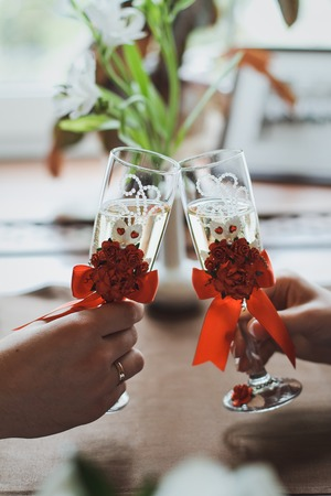 Glasses of champagne on the table, a festive table with champagne, a wedding birthday.