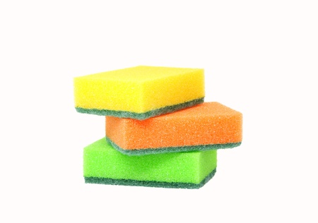 Three sponges for washing dishes on a white background Stock Photo - 14810249