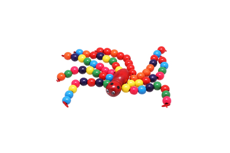 wood spider: Toy spider of bright beads. Isolated on white.
