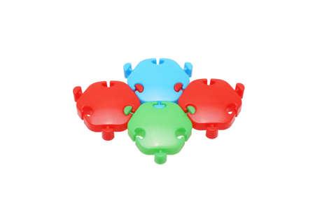 The children's designer. Plastic puzzle. Isolated on white. Stock Photo