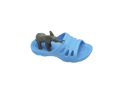toy elephant: A toy elephant standing on a slipper. Isolated on white.