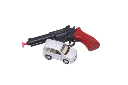 hand brake: Toy gun and car. Isolated on white.