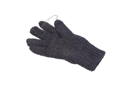 Worn needle stitched glove. Isolated on white. Stock Photo