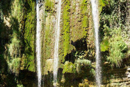 A small waterfall in the mountains. Close-up.