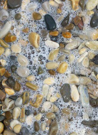 Sea pebbles and water. Close-up.