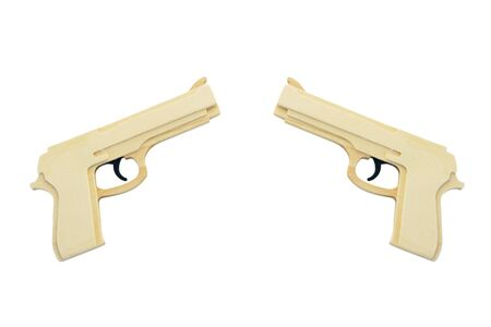 Two toy wooden pistols. Isolated on white.