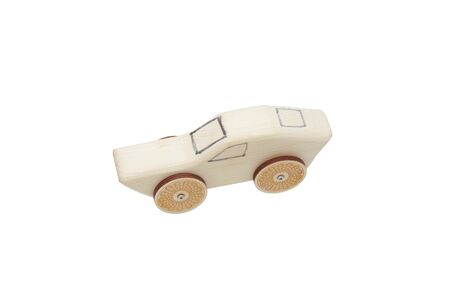 Toy car made of wood. Hand-made. Isolated on white.