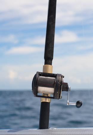 deep sea fishing: Deep sea fishing rod on seascape background