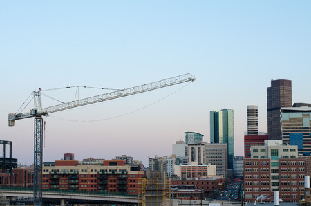 denver skyline at sunset: Part of the Denver skyline with a crane, taken from the 7th floor of a nearby apartment building.
