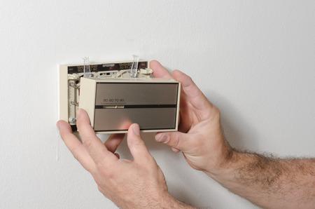 Mains suppression et la couverture plus du thermostat de style Banque d'images - 29491197