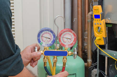 Charging a residential heat pump system with refrigerant photo