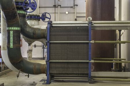 Commercial grade heat exchanger for a chill water cooling tower