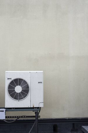 One minisplit air conditioner condenser with lots of copy space Stock Photo
