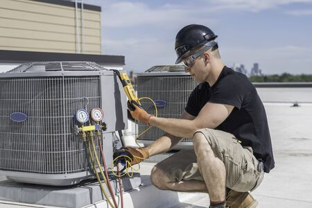 Hvac technician inspecting an condensing unit.