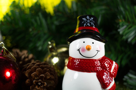 hristmas: hristmas Decoration and Ornaments- Snow Man on Christmas Tree background with Selective Focus in Vintage Color