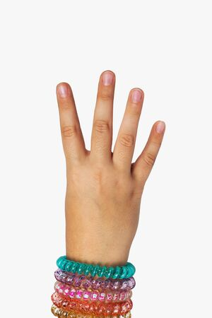 The hand of a child shows 4 Stock Photo