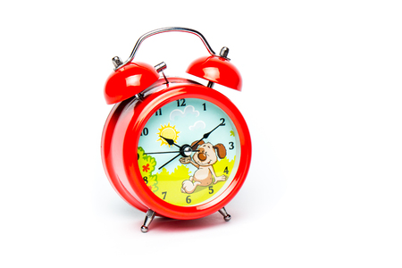 Red baby alarm clock isolated on white background, close-up