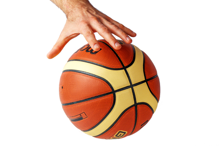 Hand reaching for a basketball on a white background